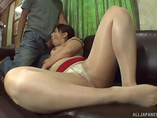 Busty Asian sweeping takes a large Hawkshaw in her mouth and eats cum